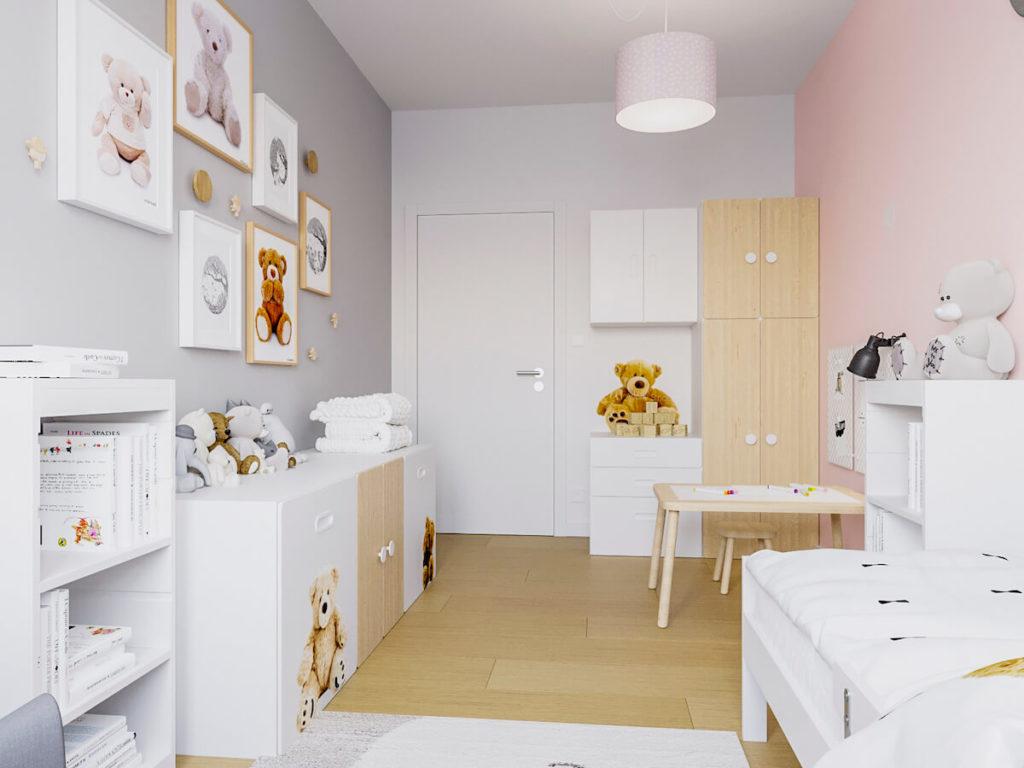 Pokój małej dziewczynki z szarą ścianą na której są obrazki z misiami i białymi meblami IKEA