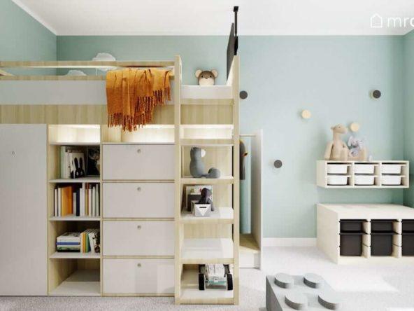 Łóżko piętrowe z szafkami i szufladami w pokoju pięcioletniego chłopca z miętowymi ścianami