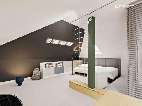 Pokój nastolatka z łóżkiem i regałami na dużym poddaszu