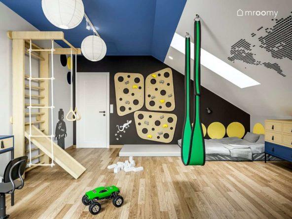 Projekt pokoju dla sześcioletniego chłopca z drabinką ścianką wspinaczkową huśtawką czarną ścianą i mapą na ścianie